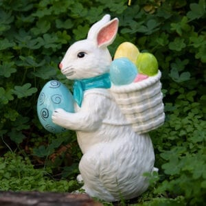 BUNNY HOLDING EGG WITH BACKPACK FIGURINE